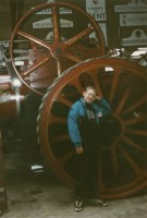 Little me standing in front of a BIG wheel.
